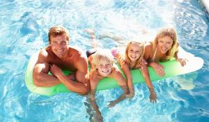 family-spending-quality-time-on-swimming-pool