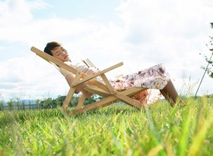 Young Woman Sleeping on Lawn Chair --- Image by © Royalty-Free/Corbis